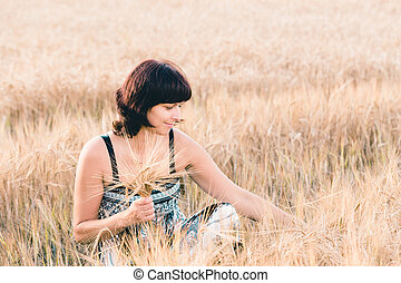 Middle aged beauty woman in barley field - Middle aged...