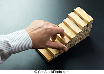 Step up concep - Businessmans fingers going up wooden blocks...
