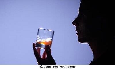 Man drinking whiskey. Close up - Alcoholic man drinking, man...
