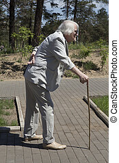 Elderly man with back pain - Elderly man goes down the...