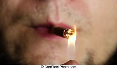 Man lights a cigarette. Tobacco. Close up - Man lights a...