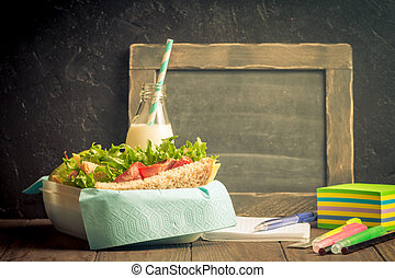 School lunch with sandwich, milk and apple