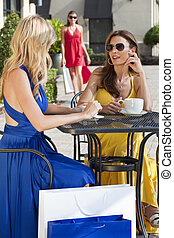 Two Beautiful Young Women Having Coffee With Shopping Bags -...