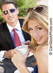 Beautiful Couple Man and Woman Having Drink At Cafe - A...