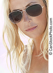 Backlit Photograph of Sexy Blond Girl In Aviator Sunglasses...