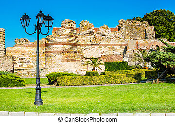 Ruins of the ancient fortress wall, Nesebar, Bulgaria -...
