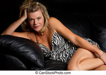 Couch Woman - Beautiful woman on leather couch