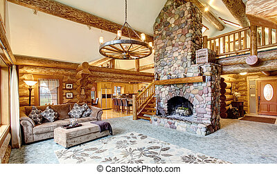 Bright Living room interior in American log cabin house.