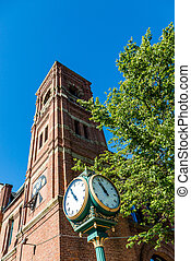 Town Clock by Brick Bell Tower in Charlottetown