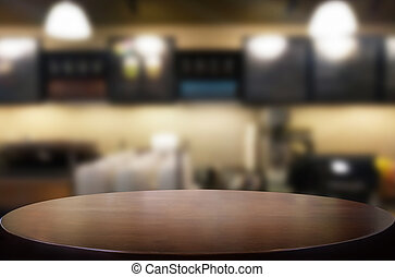 Selected focus empty brown wooden table and Coffee shop...