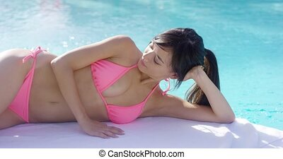 Relaxed young woman enjoying her summer vacation lying sun...