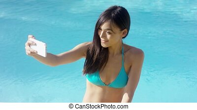 Pretty young woman taking her selfie - Pretty young woman in...