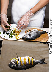 Cooked fish sea bream fish with lemon, parsley,garlic