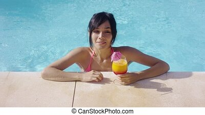 Thoughtful young woman at a summer resort relaxing in her...