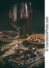 Chocolate praline with raisin and wine