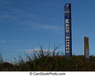Beach access sign. - Beach access sign in dunes.