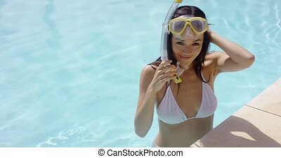 Grinning young woman wearing goggles and snorkel -...