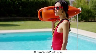 Serious lifeguard holding floatation device - One serious...