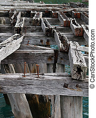 Old wharf structure, weathered beams close-up