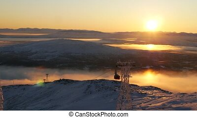 Stunning view of moving cable car in snow-covered mountaines...