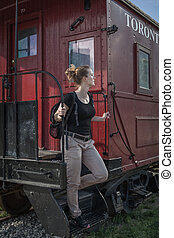The woman emerges from the historical train in Toronto,...