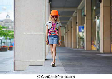 Little girl in sunglasses and orange hat. - Portrait of girl...
