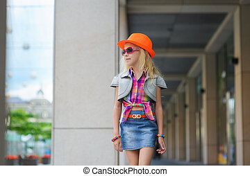 Little girl in sunglasses, orange hat. - Portrait of girl in...