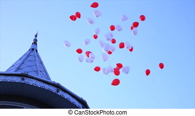 white and red balloons flying.
