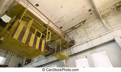 Industrial interior of an old abandoned factory building