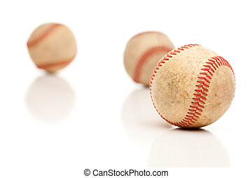 Three Baseballs Isolated on Reflective White - Three...