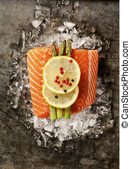 Salmon Fillet on Ice - Raw salmon fillet and ingredients for...