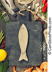Delicious fresh fish and seafood on vintage background Fish...