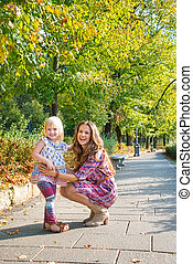 Full length portrait of happy mother and daughter at the...