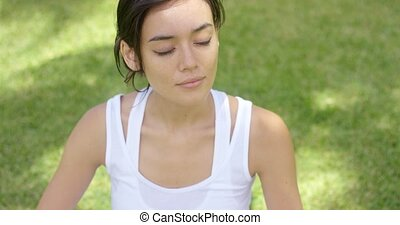 Calm young woman in white blouse with grin with copy space...
