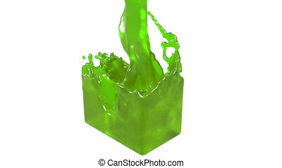 green fluid fills up a rectangular container - close-up view...