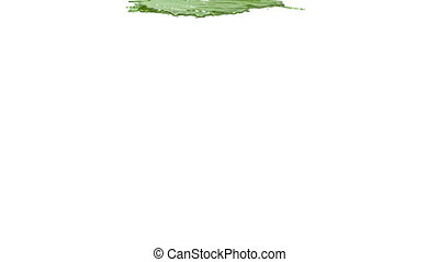 green paint pouring on white background - close-up view of...