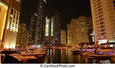 Dubai - AUGUST 7, 2014: Skyscrapers at Dubai Marina on August 7 in Dubai, UAE. Dubai Marina has very high concentration of skyscrapers