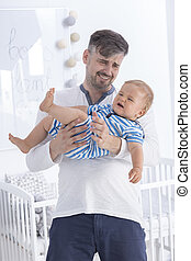 How to calm him down - Shot of a confused father carrying...
