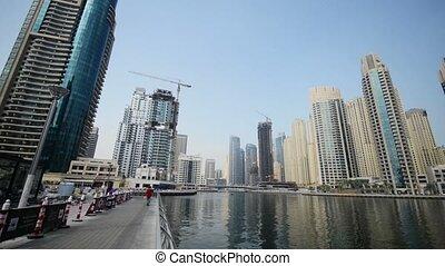 Dubai - AUGUST 7, 2014: Skyscrapers at Dubai Marina on...