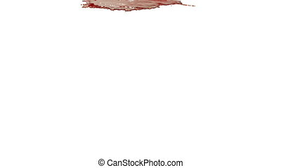 orange paint pouring on white background - close-up view of...