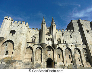 Palace de papes in Avignon on a sunny day - Facade of Palace...