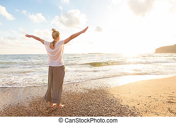 Free Happy Woman Enjoying Sunset on Sandy Beach - Relaxed...