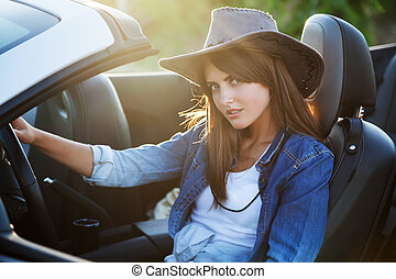 Cowboy girl driver in white convertible - Cowboy girl driver...