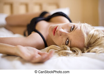 sexy blond girl on the bed - sexy blond woman with amazing...