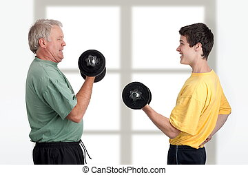 Having fun together - Father and son doing weight lifting...