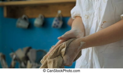 Girl wipes her hands with a cloth after job done - Girl...