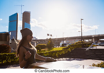 Young girl walking outdoors in city