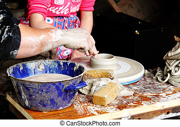 child potter shaping clay in workshop - potter learn child...
