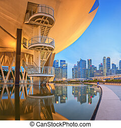 View of part of ArtScience Museum and Singapore skyscrapers in the background.