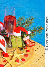 Christmas decoration and Glasses with red champagne -...